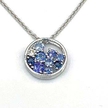 ISABELLE LANGLOIS, Pendentif or blanc 750 /°° tanzanites saphirs diamant